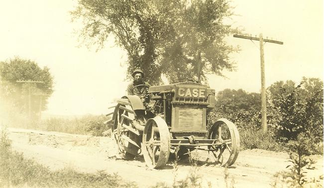 County Highway Worker on Case Tractor