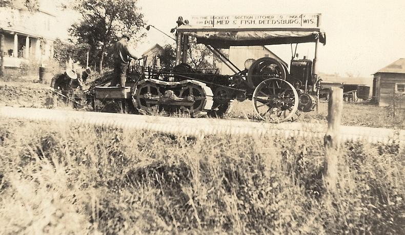 Buckeye Dacton Ditch Digger being used on a county road