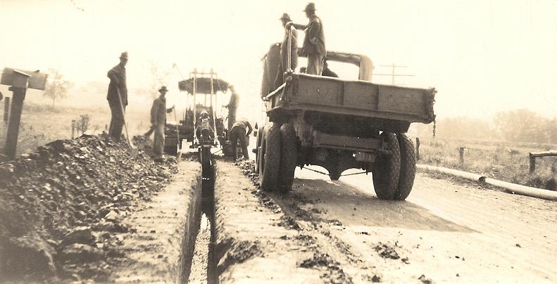 County Highway Workers orkers installing drain tile